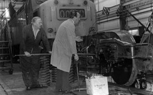 Examining bogie whe Ernie Harris supervisor George Cook fitter